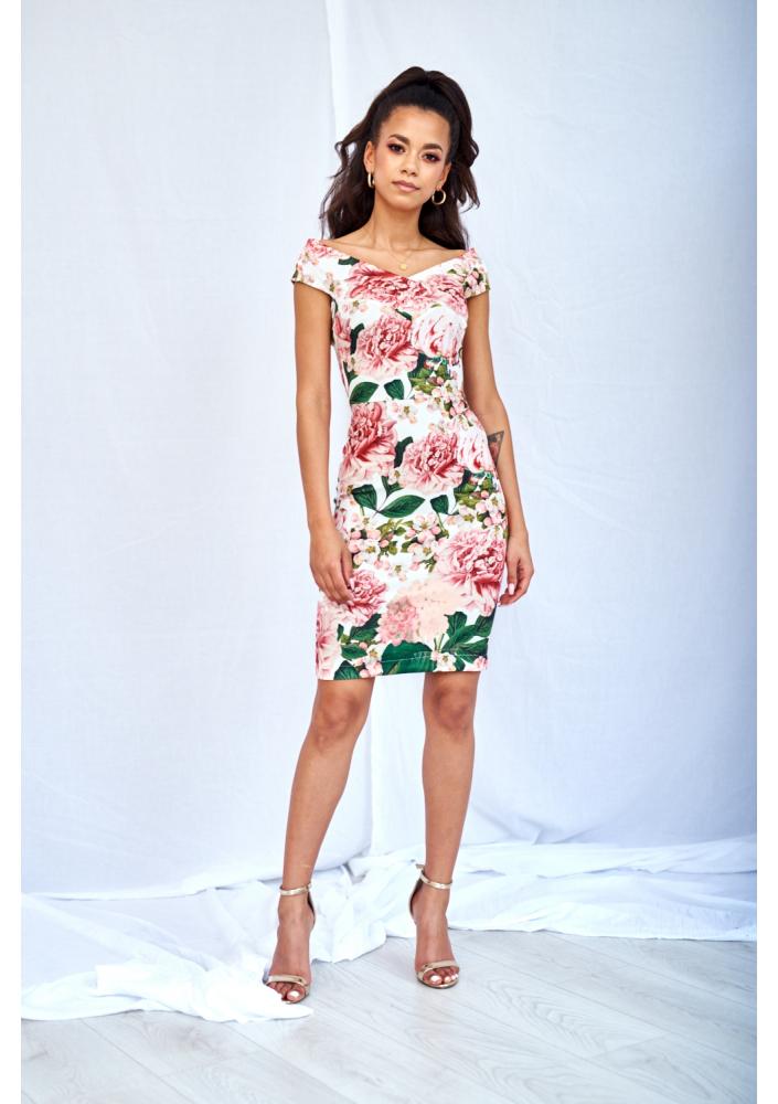 Wygodna sukienka w kwiaty o ołówkowym kroju.
