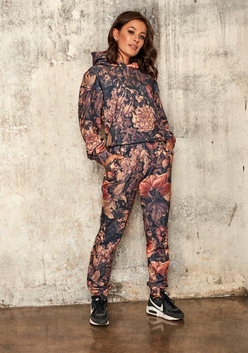 Dresowe spodnie w kwiaty Miodowe