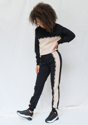 Black and beige sweatpants with logo stripe ILM