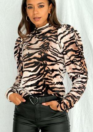 Bluza z bufką w zwierzęcy motyw