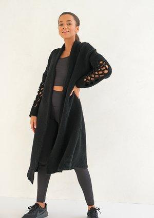 Long openwork black cardigan