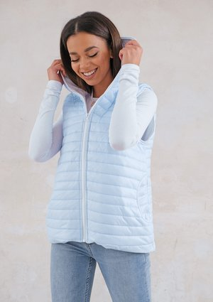 Quilted sleeveless light blue jacket