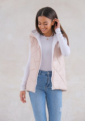 Quilted sleeveless beige jacket