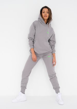 Grey sweatpants with a lime logo