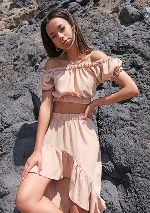 Beige top with a boat neckline