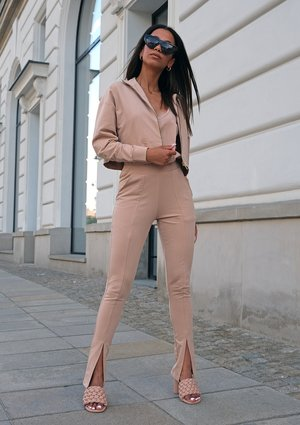 Beige pants with a slit