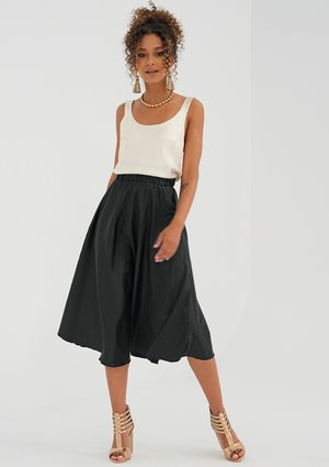 Midi black satin skirt