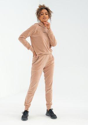 Beige velvet sweatpants with black details