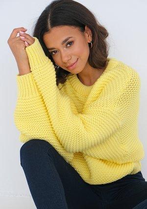 Loose yellow sweater