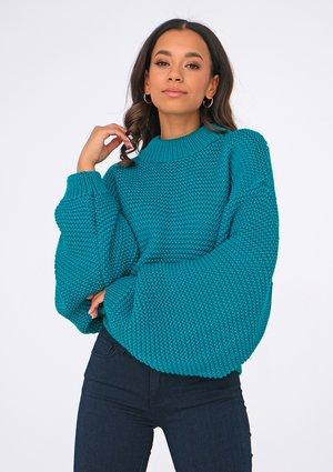 Loose green sweater