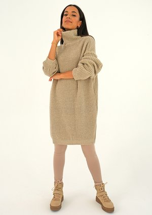 Beige turtleneck sweater with a silver thread
